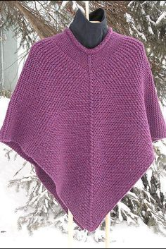 """Here's a poncho based on the number 50. • diamonds with 50 stitches on each side and 50 decreases; • side panels of 50 stitches times 50 ridges. It's as easy as counting to 50. Garter stitch in Chunky weight yarn. SIZE: TEEN/ADULT. MATERIAL: 6 balls of CHUNKY YARN 100 gm ball (135 yds/123 m) NEEDLES: 6.5mm/US10½ circular needle (80cm/30""""long) TENSION: This poncho is knit in garter stitch at a slightly looser tension than you would knit for a sweater. When purchasing yarn - the Ball Band (..."""