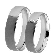 Obrączki ślubne z białego i czarnego złota z brylantami o łącznej masie 0,03 ct. Próba 0,585