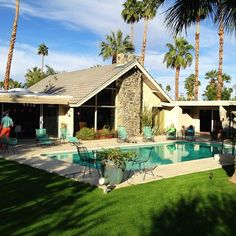 A midcentury modernist home in Palm Springs, decorated with era-appropriate vintage furniture.