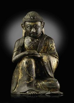 AN UNUSUAL GILT-LACQUERED BRONZE FIGURE OF SHAKYAMUNI BUDDHA -  YUAN/EARLY MING DYNASTY, 13TH-15TH CENTURY