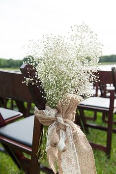 Decorate your aisle with burlap, lace, and baby's breath. Image Source: Claire Pacelli Photography