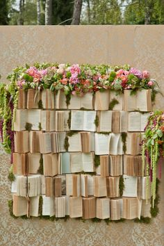 books and flowers backdrop (see also http://wedding-dreams-photos.blogspot.com/2012/09/wedding-decorations-photos.html )