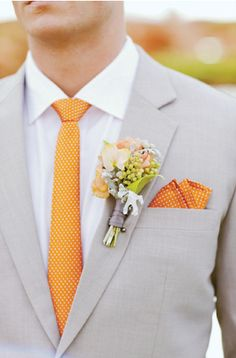 Pocket handkerchief and boutonniere looks great together. I don't think it's too much at all...