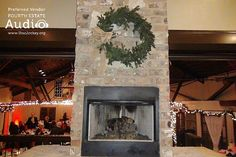 The dramatic stone fireplace in the Lager Room at the Roundhouse. http://www.discjockey.org/real-chicago-wedding-january-9-2016/