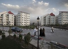 The Shark-e Arya neighborhood on the periphery of Kabul, near the airport. Shark-e Arya is one of several planned residential communities that cater to Afghanistan's new upper-middle class. Afghanistan Culture, Afghanistan War, Upper Middle Class, Arya, The Neighbourhood, Street View, Architecture, City, Travel