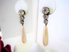 VintagObsessions offers this unique pair of faux pearl earrings which dangle from a lobe set with 3