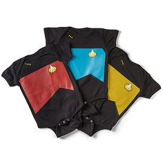 Get your child into Star Trek as early as possible with these Star Trek TNG Uniform Onesies. You can choose red for Command, blue for Sciences, or gold for Operations. These uniforms feature a 3-snap closure for when your number one