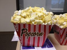 Created fake popcorn centerpieces w/ packing peanuts.
