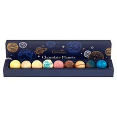 These chocolates designed to resemble our solar system look AND taste otherworldy. Luxury Chocolate, Chocolate Gifts, How To Make Chocolate, Elderberry Juice, Handmade Chocolates, Coffee Plant, Chocolate Packaging, Baubles And Beads