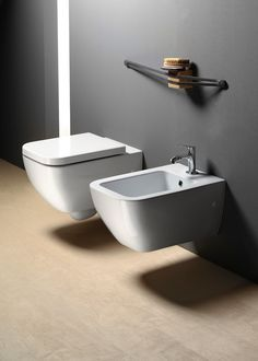 GSI ceramic | Traccia, wall-hung wc and bidet 56x35.  They have a new fixing screw from the bottom.  #GSIceramica #BathroomDesign #Sanitaryware