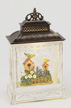 Amazon.com: A-Lan Garden Friends Lighted Water Lantern with Timer, Battery Operated, 10.8 Inches High (Yellow, Purple): Home & Kitchen Led Lantern, Lanterns, Musical Snow Globes, Water Effect, Christmas Snow Globes, Water Globes, Purple Garden, Water Lighting, White Dogs