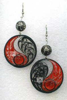 by SUSAN QUILLING.  See her blog here: http://susanquilling.blogspot.com/2011/12/beehive-jewelery-set.html