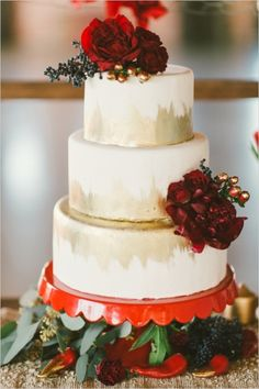 gold and red wedding cake with floral accessories #weddingcake #cake #weddingchicks http://www.weddingchicks.com/2014/02/13/spicy-love-wedding-inspiration/