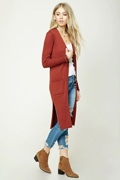 Style Deals - A longline ribbed knit cardigan featuring a V-neckline, a button front, front patch pockets, long sleeves, side vents, and a form-fitting silhouette.