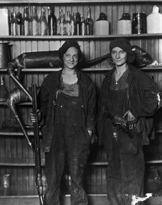 Sisters Guarding Family Moonshine Business, ca. 1921  Two sisters, Florence Friermuth and Susie Friermuth Doffing, pose in their guarding positions after they were arrested for moonshining. The sisters guarded stills on their family's farm near Saint Paul, Minnesota during Prohibition. | Location: near Saint Paul, Minnesota, USA.