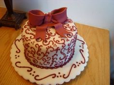 Swirl cake with bow By briggs on CakeCentral.com