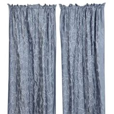 Add elegance to your drapes. These two-toned blue curtain panels have a classic scrolled embroidery pattern to accent your windows.
