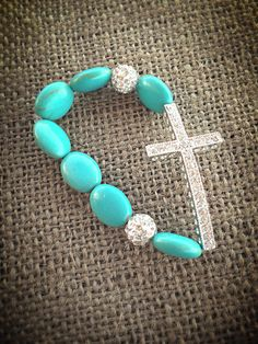 Sideways Cross Bracelet with Turquoise Howlite Beads  on Etsy, $12.00
