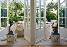 Lovely glass windowed doors leading to sunroom garden.