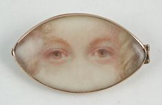 Georgian eye miniature, circa Watercolor on ivory. Unusual front view of two brown eyes, blond hair. Set in navette-shaped gold frame. Via Cathy Gordon, Olympus Imaging Corp. Victorian Jewelry, Antique Jewelry, Vintage Jewelry, Eye Jewelry, High Jewelry, Jewellery, Art Nouveau, Lovers Eyes, Miniature Portraits