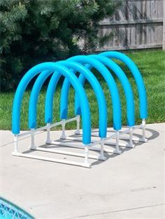 Pool Raft Holder I am going to make this for my pool stuff! you could connect the pvc pipes, add a hose and makes some holes in the noodles… Pool Toy Storage, Pool Float Storage, Backyard Storage, Pool Organization, Organizing, Kid Pool, Pool Fun, Pool Rafts, Pool Accessories