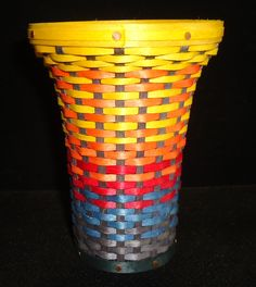 """Associated with the Sun, a Phoenix obtains new life by rising from the ashes of its predecessor.    This Miniature woven Phoenix Vase is a reflection of the mythical Phoenix. From the bottom ash gray weave to the blue (flame) that warms to red, orange and yellow.   It is a reminder that there are always new beginnings.  4.5"""" tall x 3.25"""" in circumference  $30.00 Ash Grey, Gray, Rise From The Ashes, Blue Flames, New Beginnings, Orange, Yellow, Phoenix, Weave"""