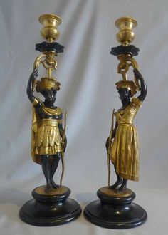 Antique Pair of French Charles X period blackamoor candlesticks representing America. - Gavin Douglas Antiques