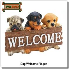"""Dog Welcome Plaque - Welcome friends and family to your home with eternally cute puppy dog faces! This charming wall plaque features three little pups holding a wood-style sign decorated with the word """"Welcome"""". Made from durable polyresin and features vibrant colors and details.  Only $20.97 plus FREE shipping!"""