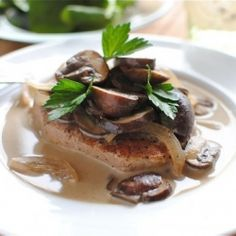 Pork chop with mushrooms in a wine sauce