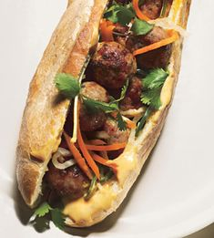 Bánh mì (Vietnamese sandwich consisting of grilled/bbq meat, pickled carrots, cilantro, peppers, cucumbers, all in a toasted french baguette).