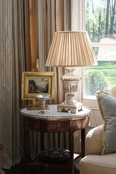 Things That Inspire: Vignettes from a show house interior beautiful room with pretty lamp and a nice painting picture frame wood classy chic