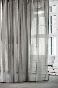 Slice drapery fabric - 100% Trevira CS Semi-transparent curtain fabric with subtle geometric patterning. Blocks with downward running diagonal cross stripes optically achieve with partial overlapping a moiré effect. The burn out looks like a paper-cut out, a look that is further accentuated by the underlying base of light cotton.