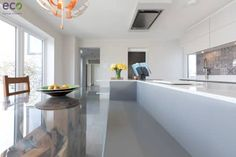Handle Less design in Modern colours: modern Kitchen by Eco German Kitchens