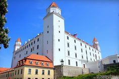 The most significant symbol of the city - the Bratislava castle - is located in the very center of Bratislava. Its interesting design with four towers on each side shapes the panorama of Bratislava from every angle. Bratislava Slovakia, Capital City, Old Town, Rick Steves, Castle, Europe, Train, Adventure, Building