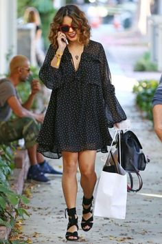 Vanessa Hudgens wearing Jacquie Aiche Pave Black Agate Arrowhead Necklace, Bobby No. 3 Signature Backpack, Raye x For Love & Lemons Myra Heels in Black and Kate Spade Amberly Sunglasses