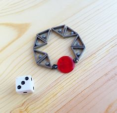 Silver triangle and red circle bracelet by CraftingAwayTheFeels on Etsy