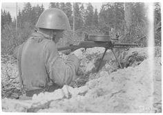 A Finnish soldier with a light machine gun. Date taken: June Light Machine Gun, Historian, World War Two, Finland, Ww2, Riding Helmets, Archive, Military, Pictures