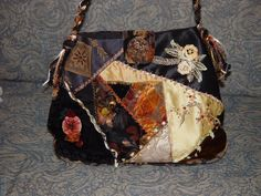 I ❤ crazy quilting . . . Roses on the Water   Sharing my love of crazy quilting, silk ribbon embroidery, and beading. This is the front of the bag.  My design and the first of many purses.