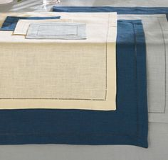 Festival Placemats & Napkins by Sferra.  Heavyweight linen finished by hand & a row of refined thread-drawn hemstitching.