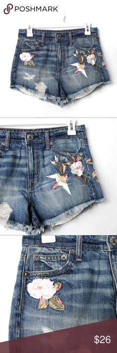 American Eagle High Rise Festival Shorts C026 American Eagle Vintage Hi-Rise Festival Shorts with embroidered bird and flowers. High waist, cutoff frayed raw hem, super soft vintage feeling denim.   • Excellent condition • Cotton • Waist: 14 inches across  • Rise: 10 inches  • Inseam: 2.5 inches   #C026.0406.02 American Eagle Outfitters Shorts Jean Shorts