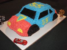 Race Car Cake - This cake is perfect for the racing fan!!  And perfect for Father's Day!! I actually made this one for my dad's 55th birthday, so I used the number 55 to go on the sides of the car!! I used the Wilton 3D cruiser pan for this and it was all made with buttercream icing!!
