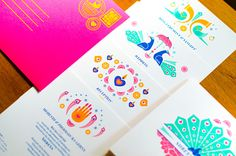 A colourful and vibrant card that still keeps it elegant. Bearing motifs of a mehendi covered hand, peacocks, parrots, tutaris and diyas, this invitation is strictly for a couple who loves to have fun. What's more, the envelope keeps it up too, in bright …