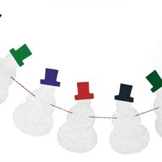 Variation on this craft: infuse to stiffen the fabric, have kids decorate each snowman. Give snowman garland as a Christmas gift.