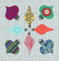 How much fun are you having with Tina Curran's Christmas applique shapes? This week you can download the free ornaments block pattern.