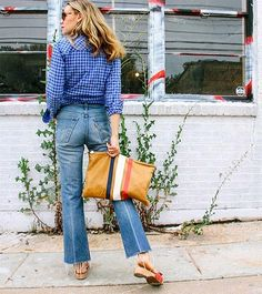 Is This the Shoe Style All the NYC Girls Will Wear? via @WhoWhatWear Cheap Ripped Jeans, Dr Scholls Sandals, Cropped Jeans Outfit, White Bikini Bottoms, Nyc Girl, Wooden Sandals, Jean Outfits, Vintage Denim, Fashion Looks