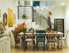 Fabulous use of old mismatched chairs in a modern setting to create a truly eclectic vibe.