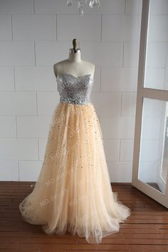 Glittering prom dress   The top is made of silver sequin ( available in other colors)  Beaded sash at the waist   Puffy skirt, made of champagne tulle, hand sew the sequins on the tulle   Sweep train at the back   Dress comes in different colors, please message me for color chart  Th...