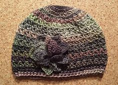 """This pattern uses less than one skein of Red Heart Boutique Unforgettable yarn. It is a simple pattern, using the V-Stitch, worked in the round. Gauge is not necessary and the hat can be made bigger or smaller by using a a larger or smaller hook size, or by adding more rounds for additional """"slouch"""". It is a lacy, light weight hat."""