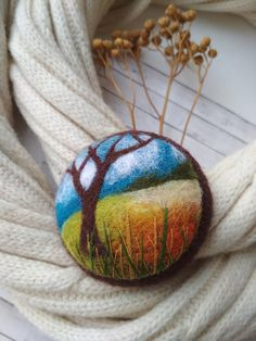Unique needle felted brooch with the image of the autumn landscape. Brooch made of wool in orange tones. Brooch is fitted with a metal brooch pin. 6 cm in diameter Please note that In reality colors of brooch may look slightly different than colors in photos on your screen. It