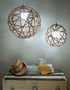 Bamboo Orb lighting made from bamboo rolled shade; undo the string from the shade and you're left with flexible strips of bamboo that you can form into spheres